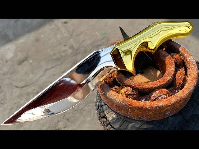 turning a rusty bearing into shiny but razor sharp combat knife