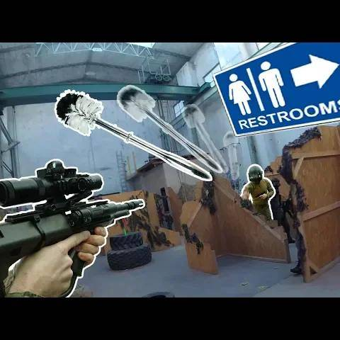 guy hits people with toiletbrush at airsoftgame