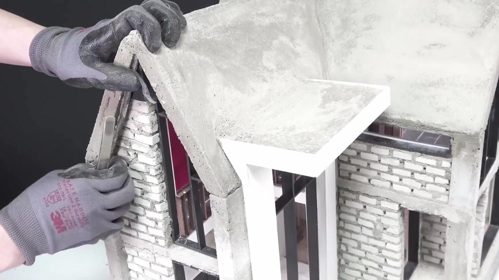 手工模拟微型建筑盖房子