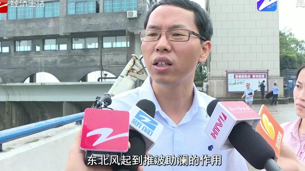 多辆汽车被冲跑 昨日钱江潮为何发飙?